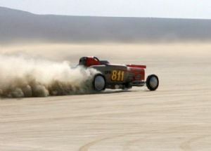 Dave Davidson on a 228.95 mph record setting run in his C Fuel Roadster at El Mirage. The record stood for 4 years. This '29 Ford builds 1400 HP and 1140 foot pounds of torque. Dave's fastest run to date was October 9, 2009 at Bonneville: 261.824 mph!